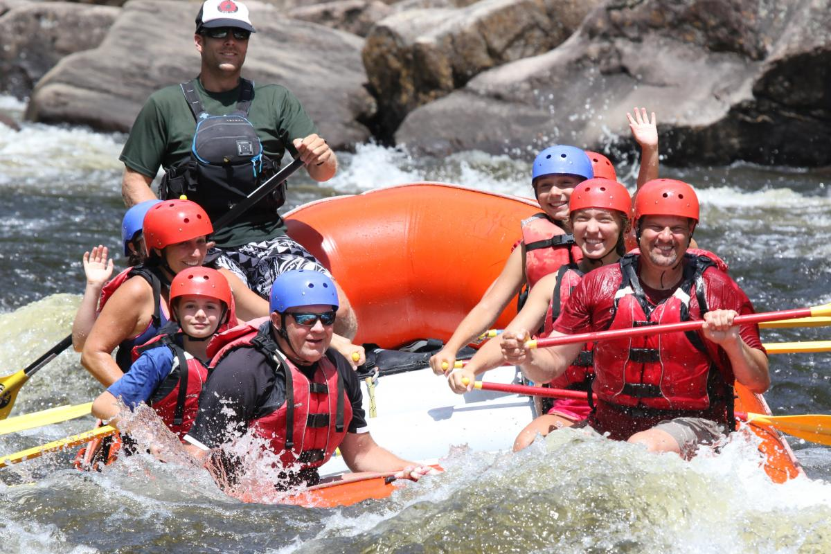 Big family of rafters paddling Hudson River whitewater
