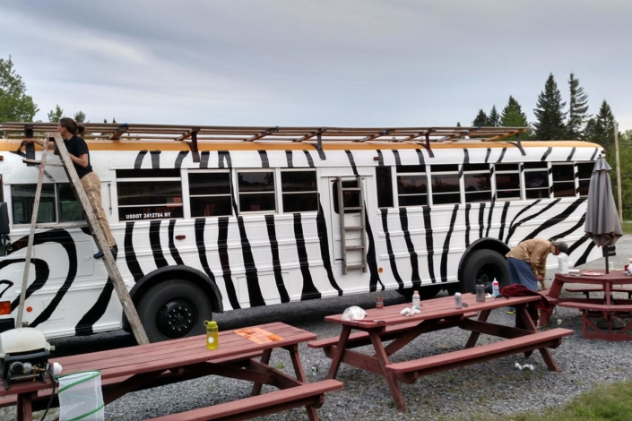 Guides paiting the Zebra bus