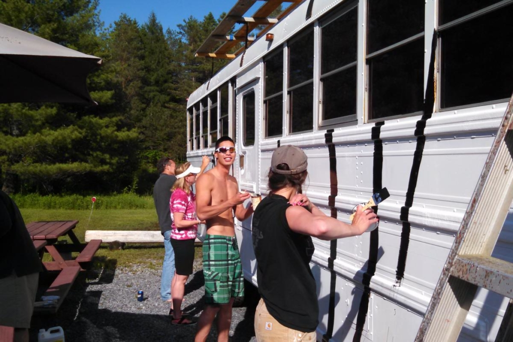 Guides painting the bus