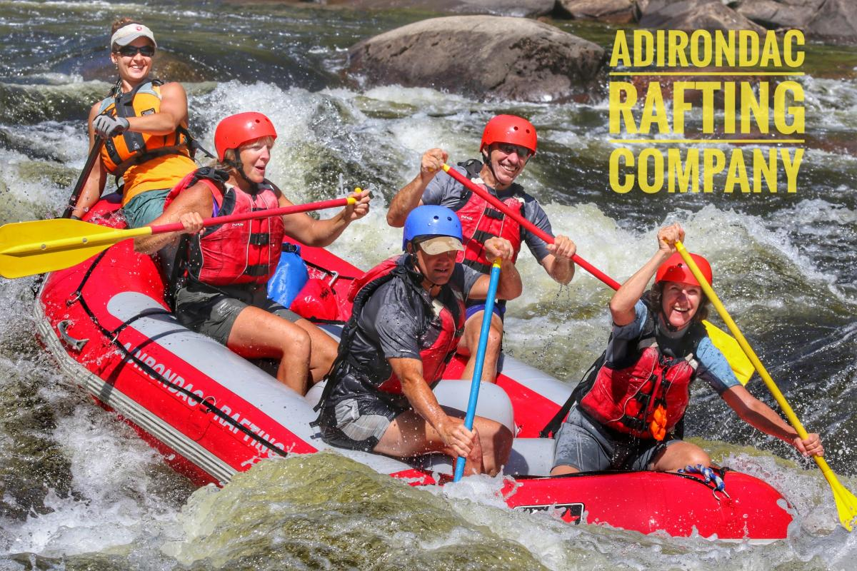 Rafters paddling whitewater with ARC logo