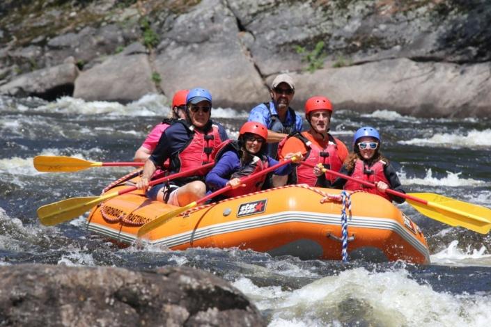 Raft entering a rapid