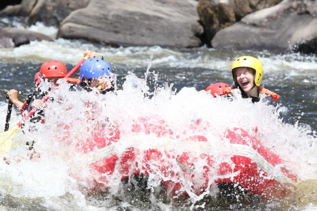 Raft splashing through a wave