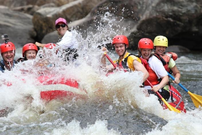 Raft hitting a big wave
